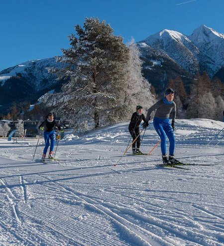 Cross-country skiers and downhill skiers